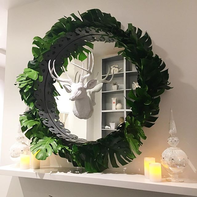 I've had the pleasure of decorating this mirror and mantle the past five years but this year might be my favorite. It's no secret I'm obsessed with tropicals and to take into Christmas is just 👌🏼. So thankful to have clients who are daring and appreciative of a little something different! #monsterawreath #tropicalholiday