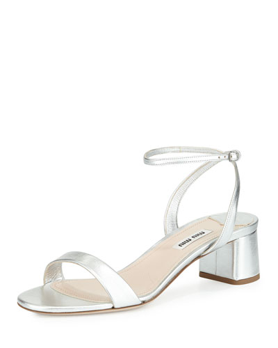 Dainty silver shoes that remind me of Daisy Buchanan in the Great Gatsby. Because let's be honest, Daisy would ONLY wear Miu Miu while ruining people's lives.  Miu Miu metallic block heel sandal, $495, at  Neiman Marcus .