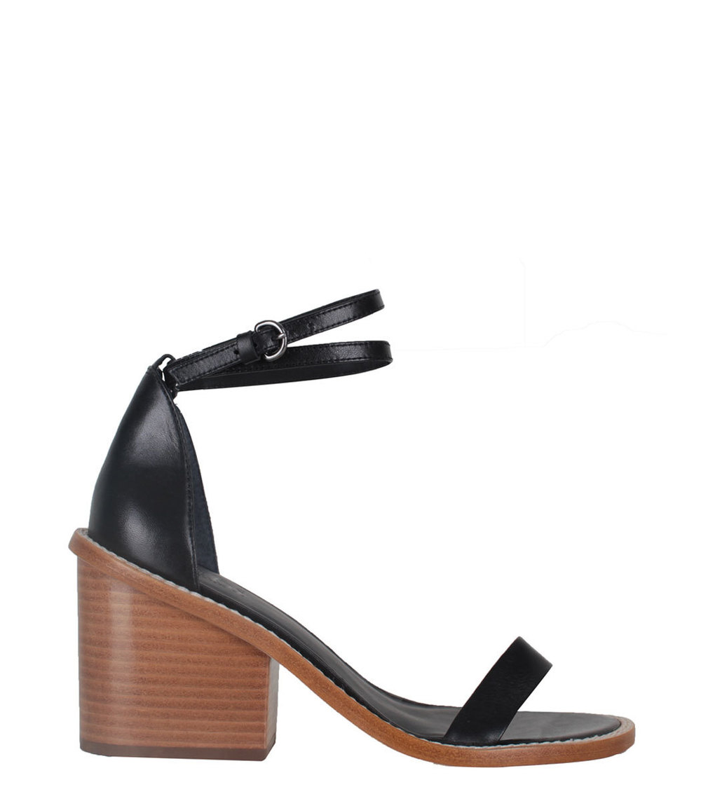 The contrast of an earthy block heel with sumptuous black leather is sleek and modern on these Tibi sandals. I think it would look smashing with this  Isabel Marant jumpsuit . Tibi sandals, $385, at  ShopBazaar .