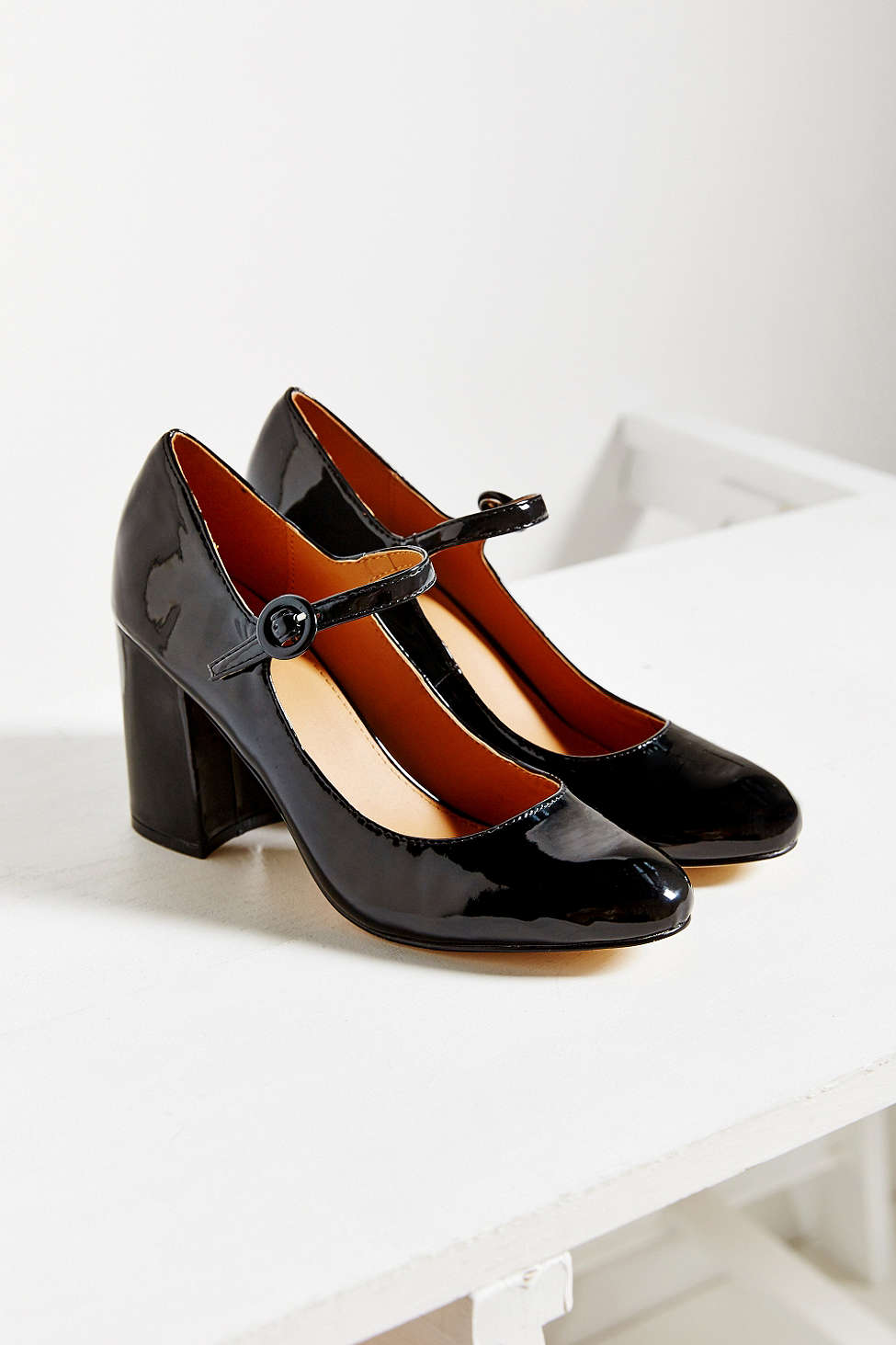 There's a coquettish charm to these patent vegan leather Mary Janes.  Maude patent heel, $59, at  Urban Outfitters .