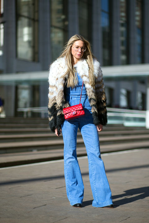 Overalls, fur, geeky glasses and a red Chanel bag? YES PLEASE. Via  Harper's Bazaar .