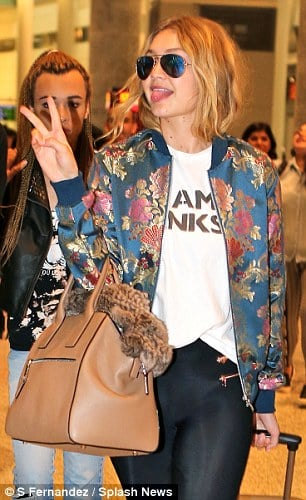 This floral print looks jut like your grandma's curtain but Gigi Hadid somehow makes it look awesome /  Via Daily Mail