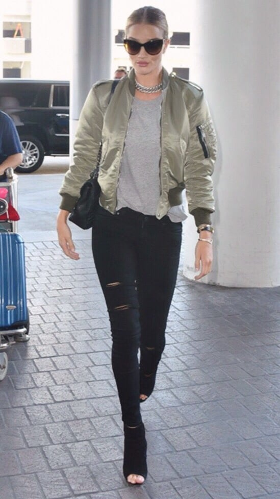 Going to the airport never looked  so  cool. Rosie in a Saint Laurent number! / Via  Flywheel