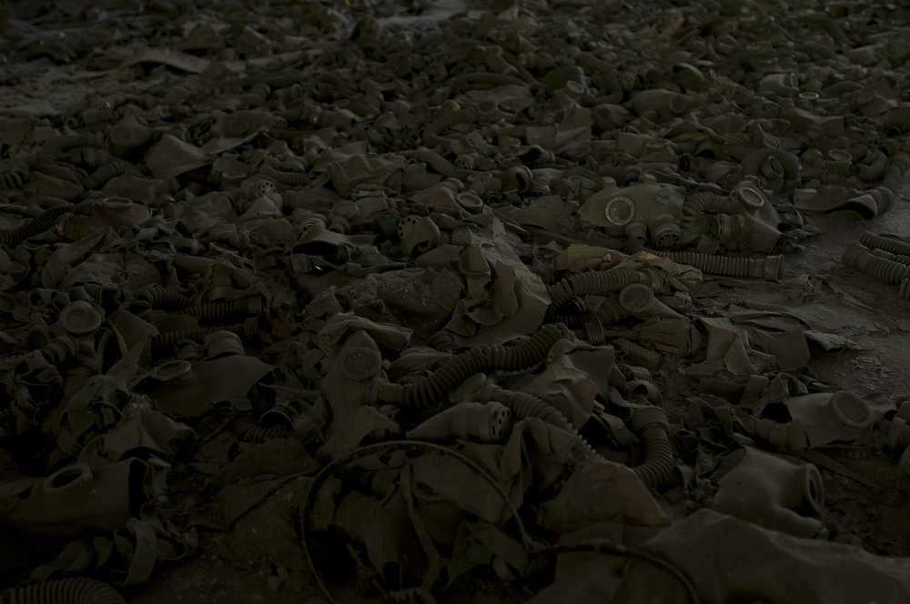 Children size gas masks displayed on the ground of Pypiat's school. None of those masks were used or have been brought here during the catastrophe