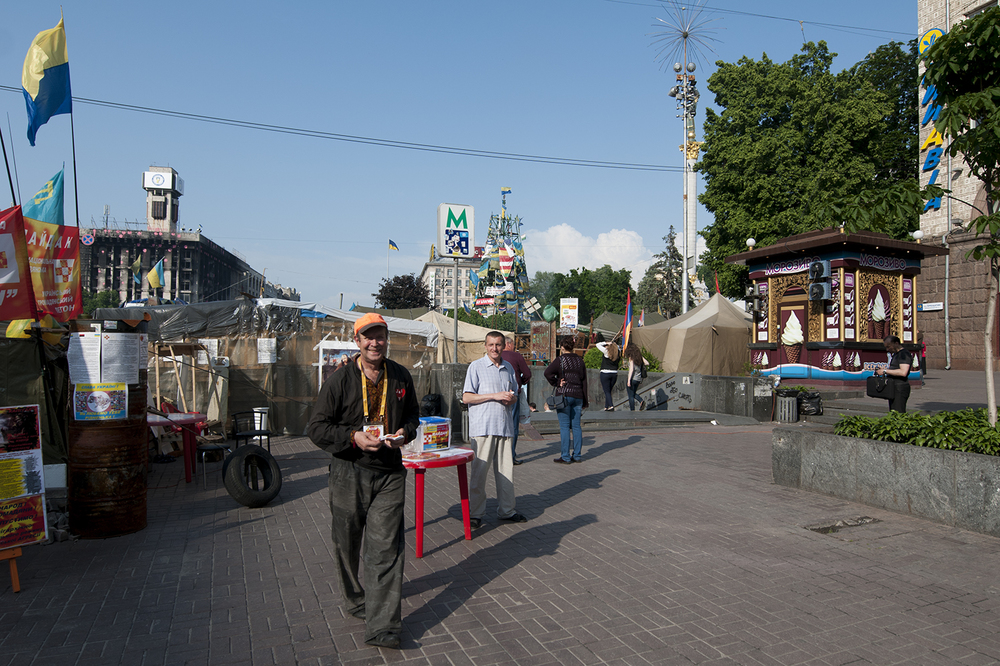 A man distributing flyer on Maidan square