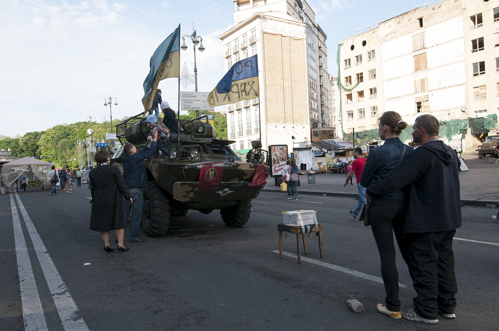Kids playing on an immobilized APC, Maidan