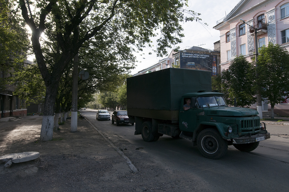 A camouflage truck driving through Horlivka