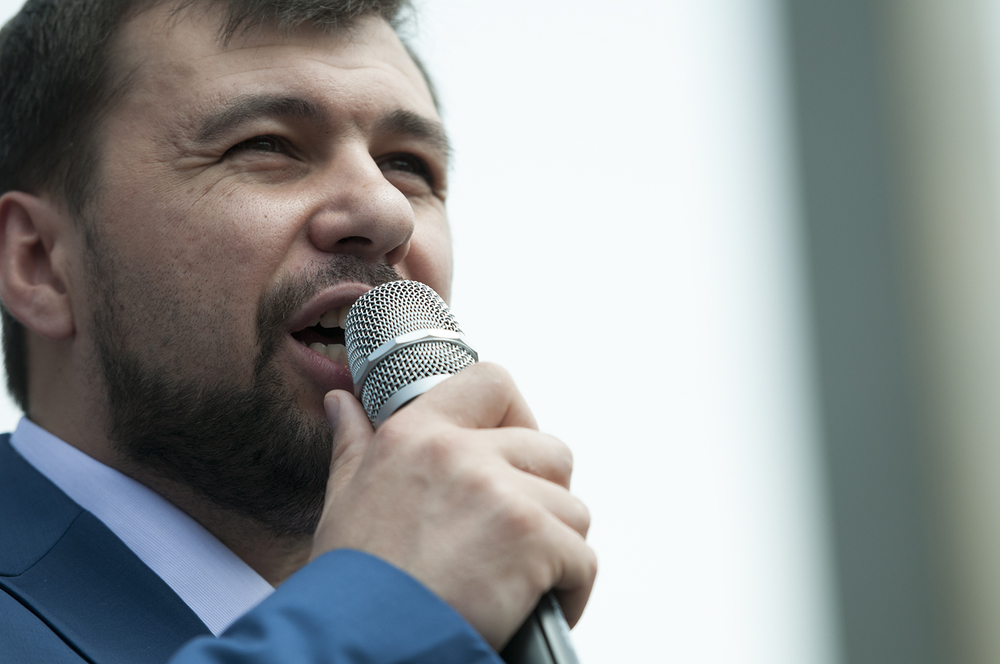 The chairman the Donetsk People's Republic, Denis Pushilin, speaking to the demonstrator on Lenin Square a jet from the Ukrainian Army flys over the city of Donetsk