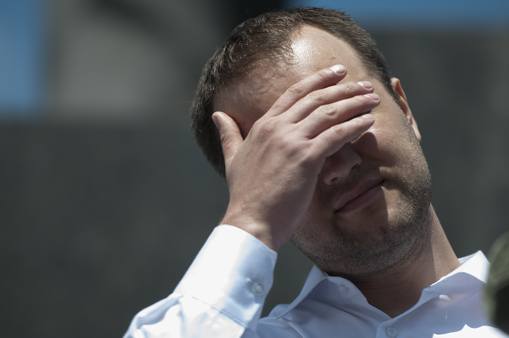 Pavel Gubarev, Governor of the Donetsk People's Republic , protecting his eyes from the bright sunlight