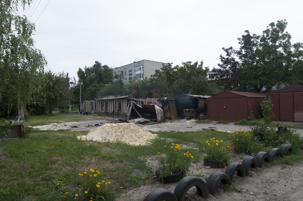 Garages hit during the night between by artillery fire the 11 and 12 of July in a residential neighbourhood of Marinka which is located 30Km west from Donetsk city center. Three civilians died during this attack