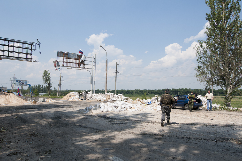 Soldiers from Battalion Vostok controlling a car in the middle of their checkpoint? The blokpost have came under heavy fire the 21th of July