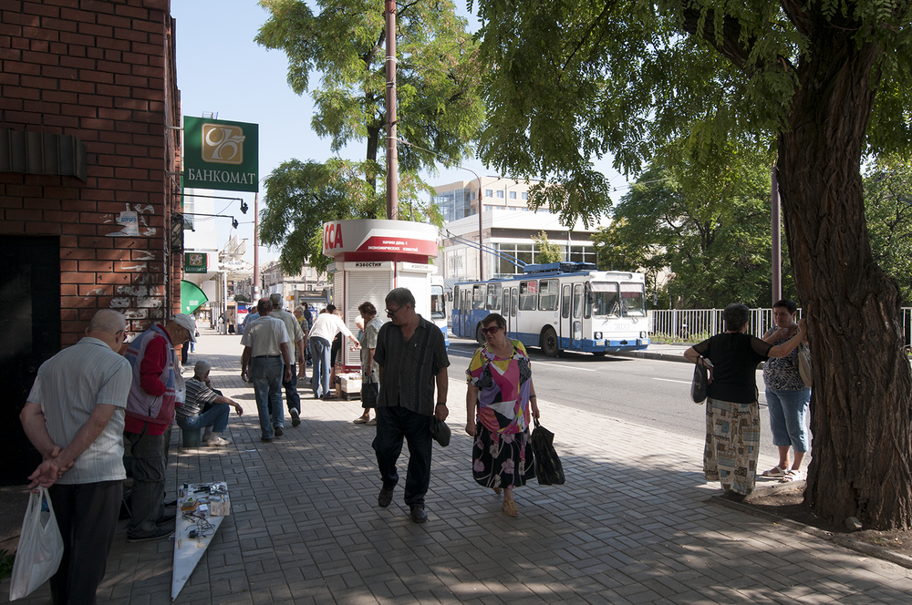 Pedestrian looking over merchants
