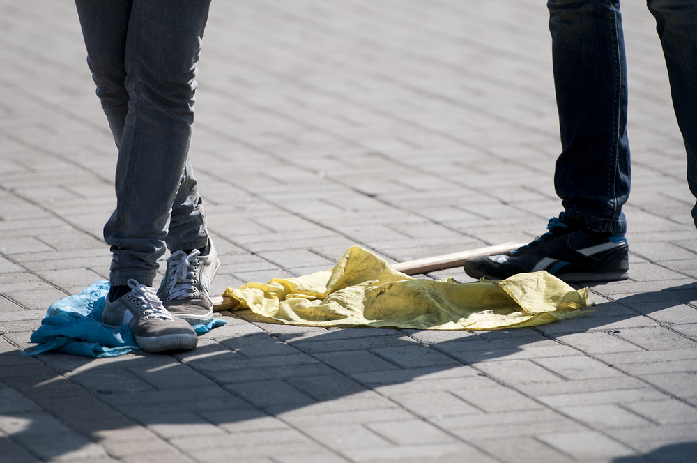 A young couple walking over the Ukrainian Flag