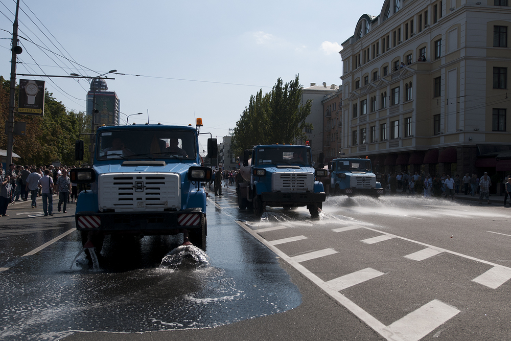 "Three water trucks ""cleaning"" the streets after the Ukrainian prisoners"