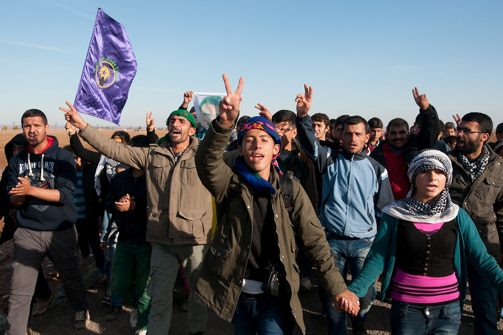 Kurdish rally marching in direction of Çaykara, a small village bordering with the Syria and the town of Kobane.