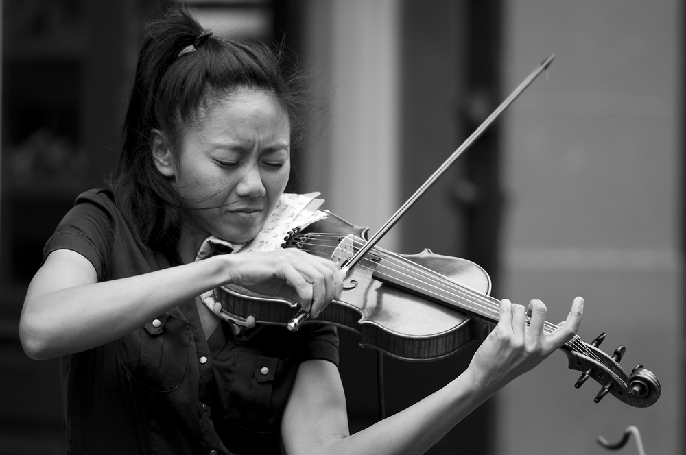 Tanya playing violin on Royal Street.