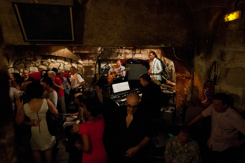 People dancing as a jazz band plays in the cellar of the Caveau De La Huchette.