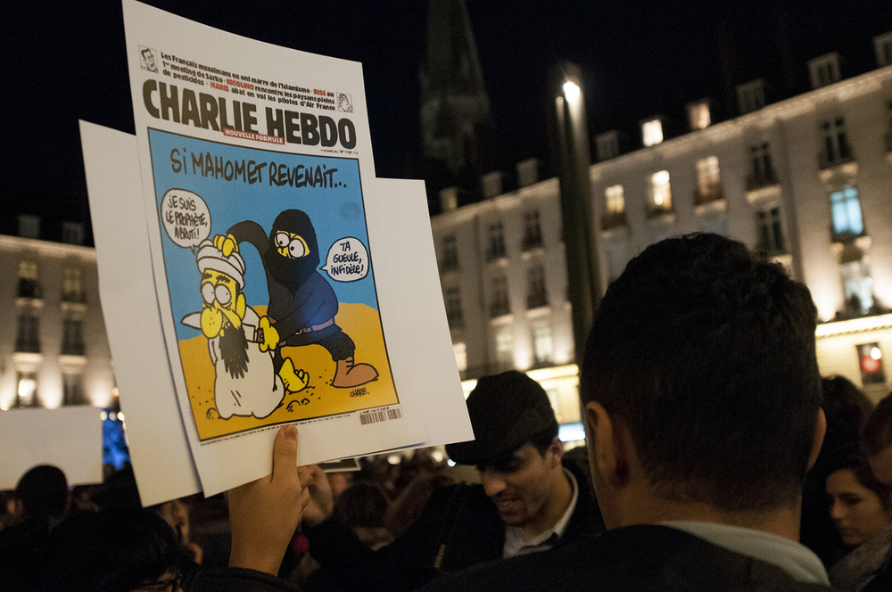 "front page of Charlie Hebdo ""I am the prophet morron!"" ""Shut up Infidel"""