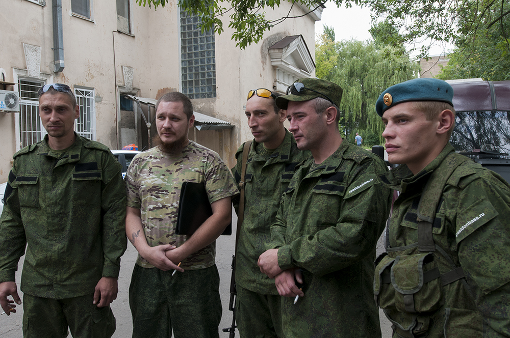Aleksei, second from the left, with his men from the Patriot Battalion at Donetsk morgue waiting for the remains of their fallen comrade
