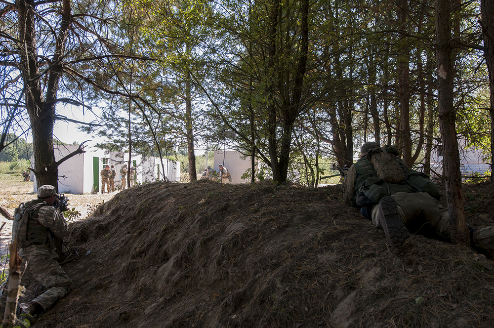 Ukrainian soldiers clearing the fake village building by building.