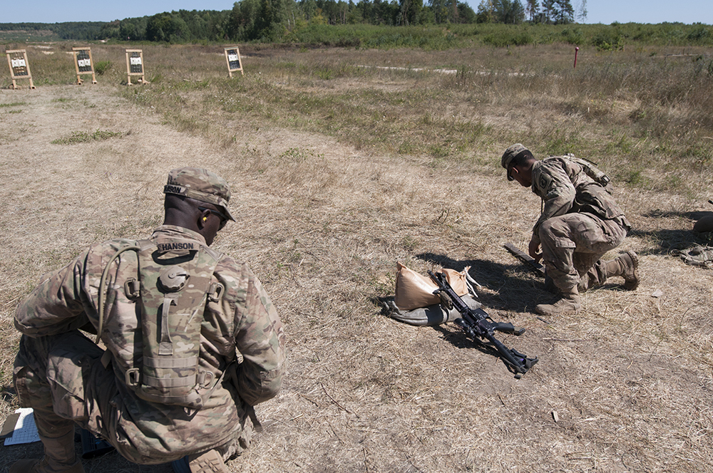 U.S. soldiers from the 173rd Airborne Brigade searching and gathering their ammunition casings.