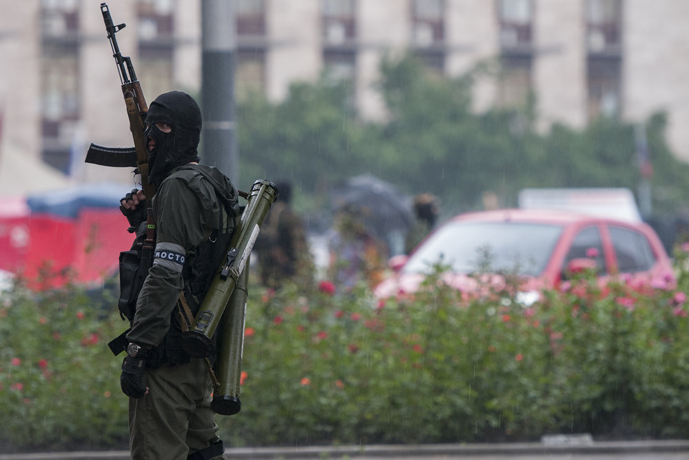 Separatist guarding the access to the Regional Administrative Building in Donetsk