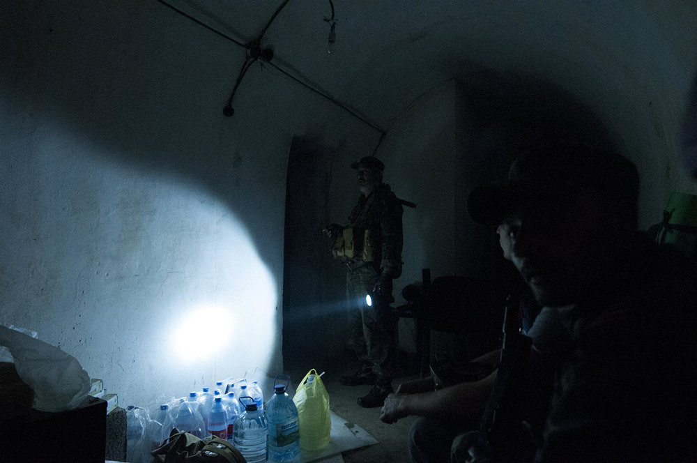 Pro-russian separatists sheltering in their bunker outside of Marinka during shelling