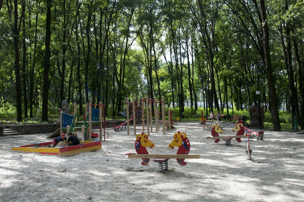 Kids playing under the watch of their mothers in one of Donetsk's numerous park