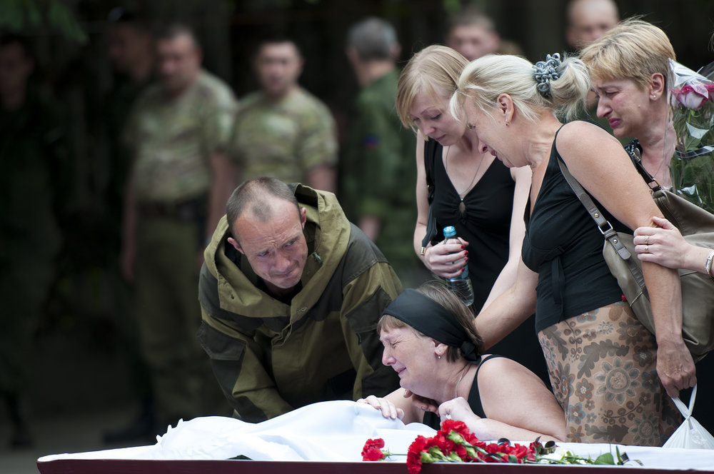 Family of a pro-russian rebel morning over his coffin during the military ceremony