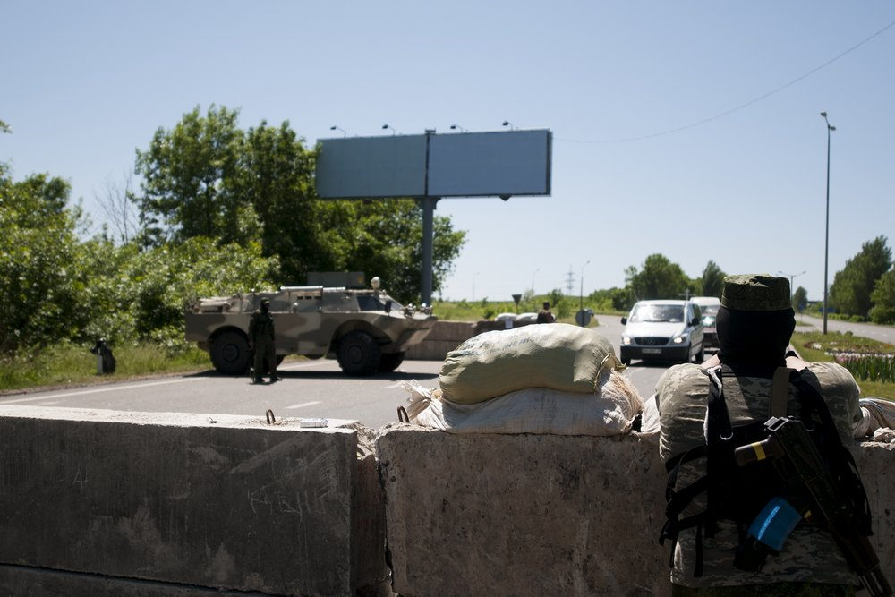 Separatist manning a checkpoint at the entrance of Donetsk
