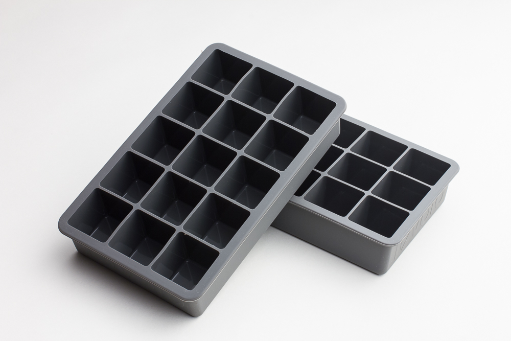 "Tovolo Perfect Cube Trays make 1"" square ice cubes perfect for stirring cocktails."