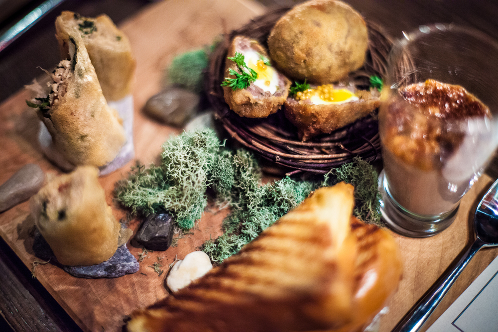 Hors D'oeurves Platter by Executive Chef Joanna Rockwell - rabbit spanakopita, scotch quail eggs, and rabbit liver parfait topped with bacon jam and a side of grilled toast. Photo by Shawn Michael.