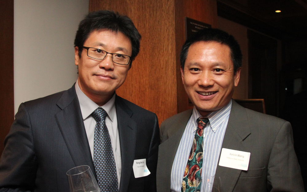 Hongchau Liu from Texas Tech University visits with Kelvin Wang, SPTC Associate Director from Oklahoma State University.