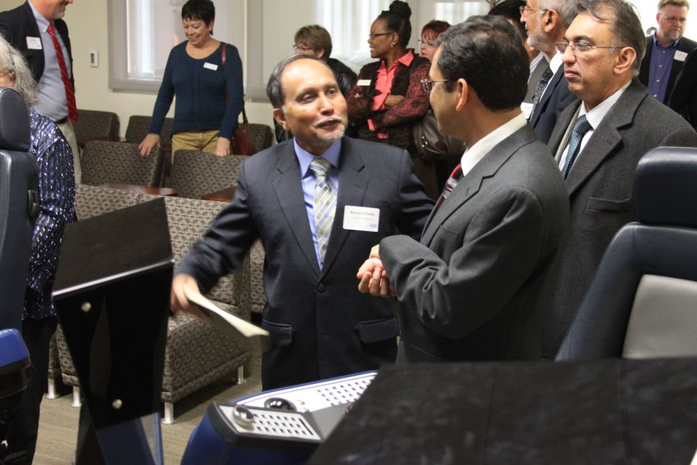 Dr. Musharraf Zaman enjoys showing guests the National Oilwell Varco Off-Shore Drilling Simulator in the REPF.