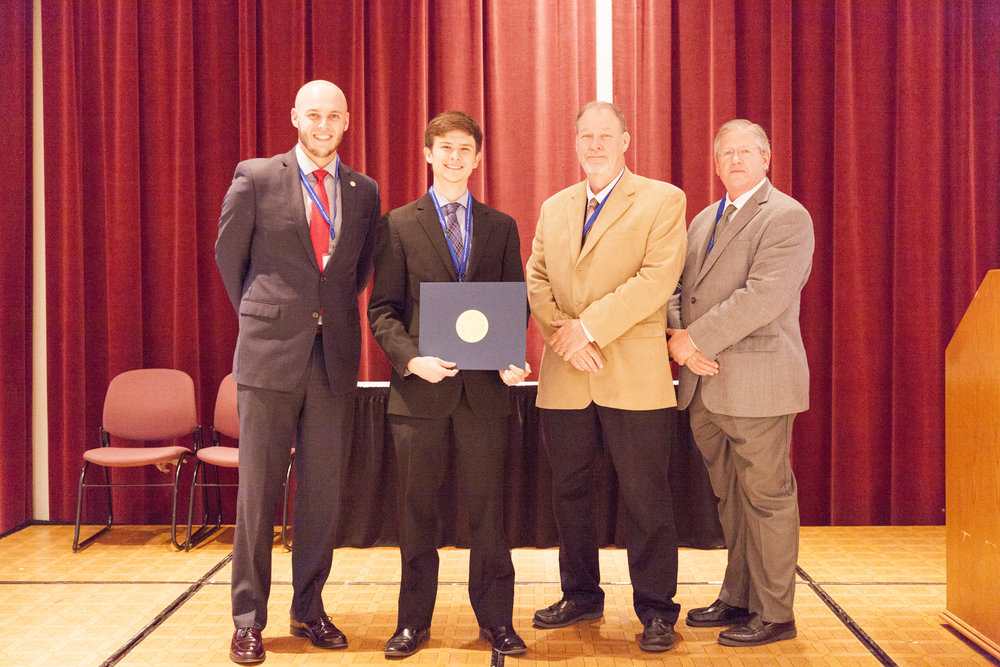 """Connor Dugan – OU – wins 1st Place in the Oklahoma Transportation Research Day Poster Competition for his work titled """"Effects of Waste Vegetable Oil in High Concentration Recycled Asphalt Binder""""."""