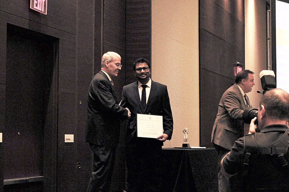 Nur Hossain (OU), SPTC's 2018 Student of the Year, receives his award at the Council for University Transportation Center's Annual Banquet in Washington DC, January 6, 2018.