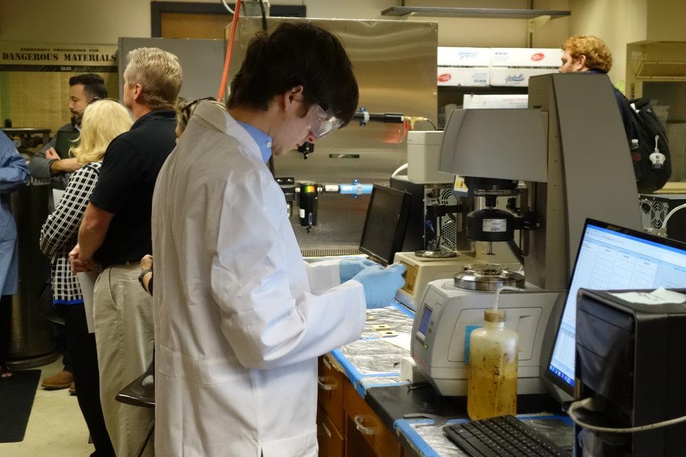 Connor Dugan preparing equipment in OU's Asphault Lab facility.
