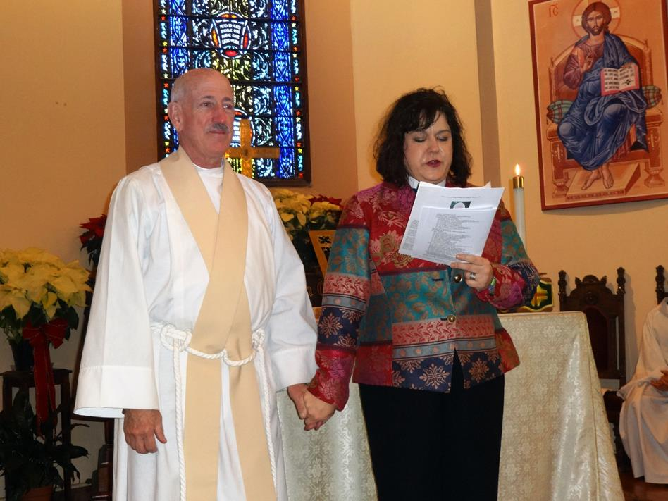 Canon Stefani Schatz read a proclamation from Bishop Marc honoring the work of Fr. David Rickey.