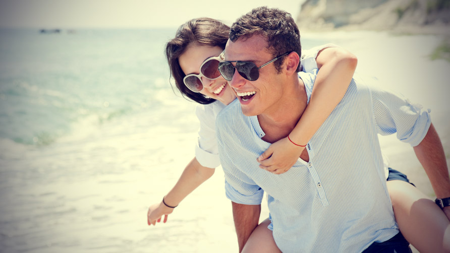 happy-couple-having-fun-on-a-beach.jpg