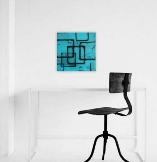 Teal and turquoise abstract painting on wall