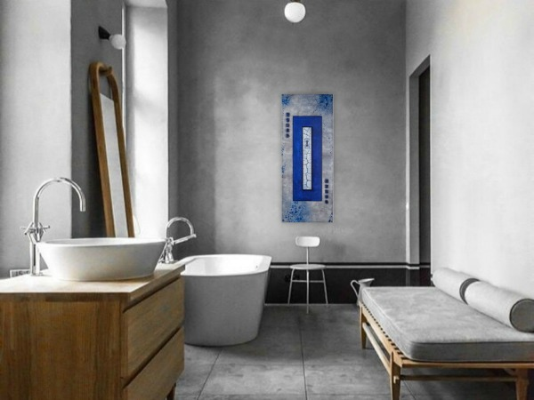 asian style abstract painting hanging on a modern bathroom gray wall