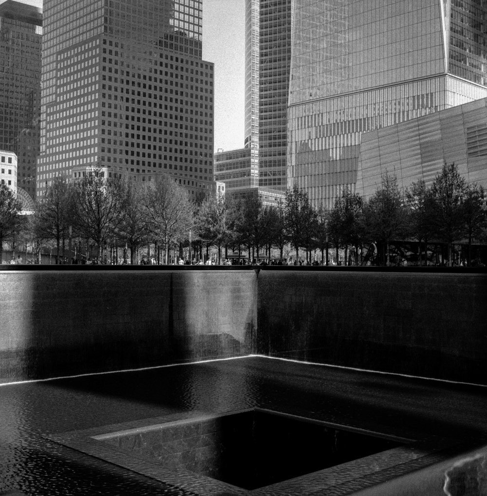 The Very Moving 9/11 Memorial in New York City. Note the grain in the sky.