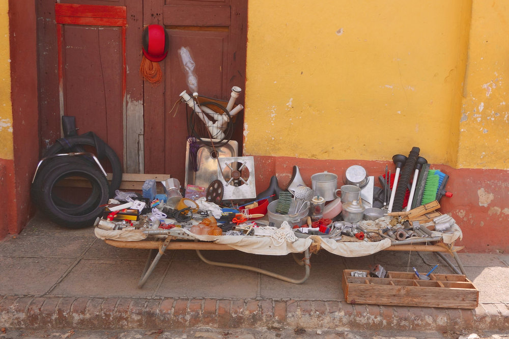 Plastic and metal parts sold on the street in Trinidad.