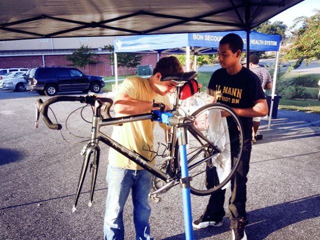 Fixing bikes together – working and learning.