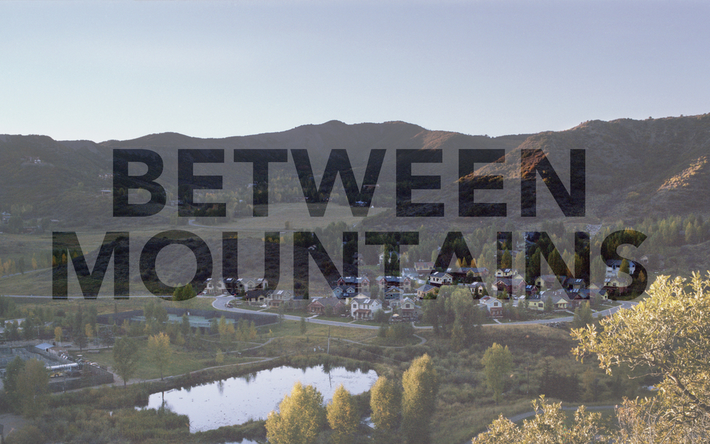 "Promotional graphic for ""Between Mountains"""