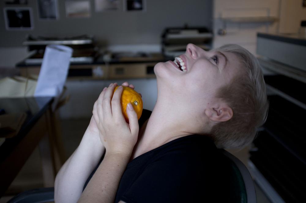 hwphoto1meal :     Photographed: Caroline Hudson-Naef and her Orange   Location: Photo Finishing Room, Arizona Sate University, Tempe, Az     Caroline being a Winogrand photo: