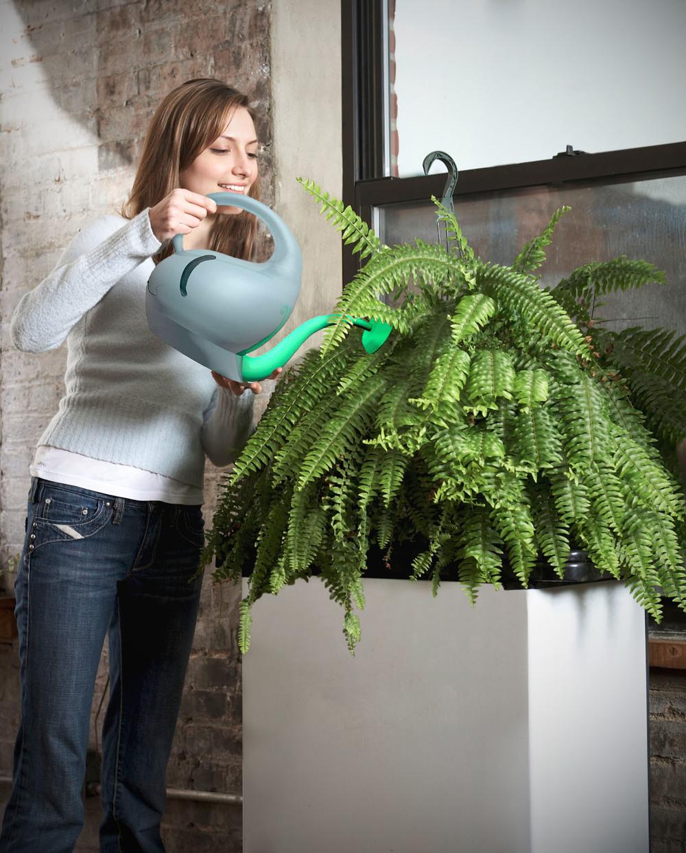 tembo woman watering.jpg