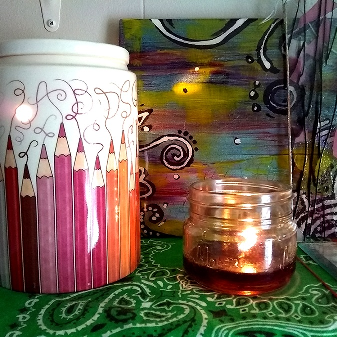 My Scentsy warmer, a candle, a painting I made and love, and a beautiful piece of glass.