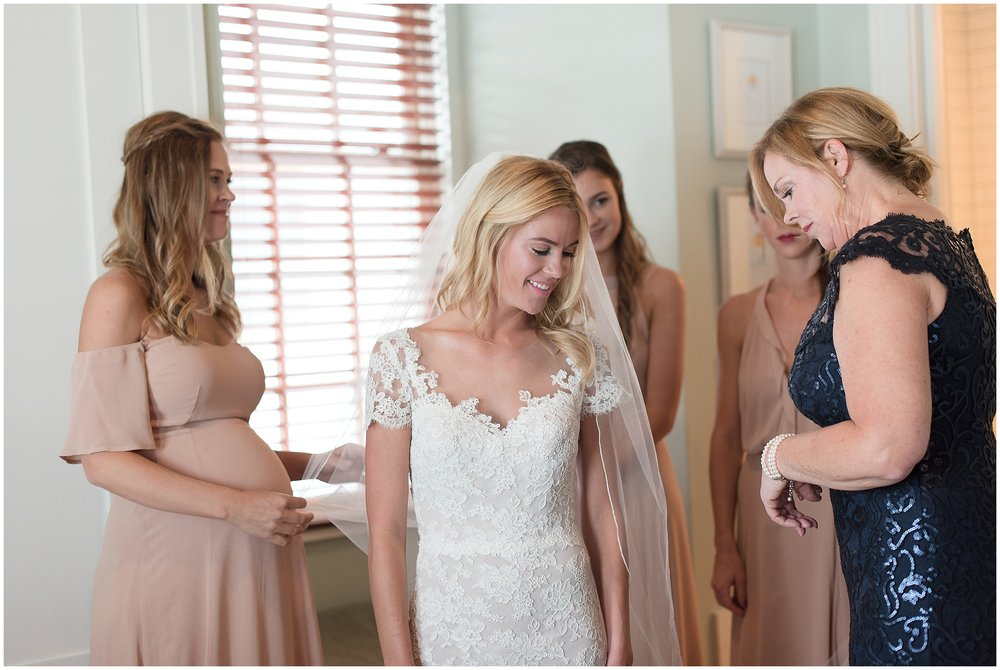 Bride getting ready shot with mom and sisters in Rosemary Beach, Florida.