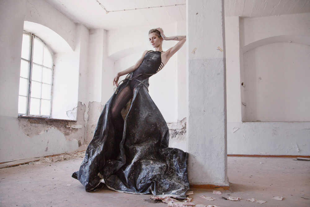 Roxanna Walitzki, shot by Redd Walitzki, in an abandoned building in Pula, Croatia, wearing a dress constructed from plastic tarp and rope sourced on site.